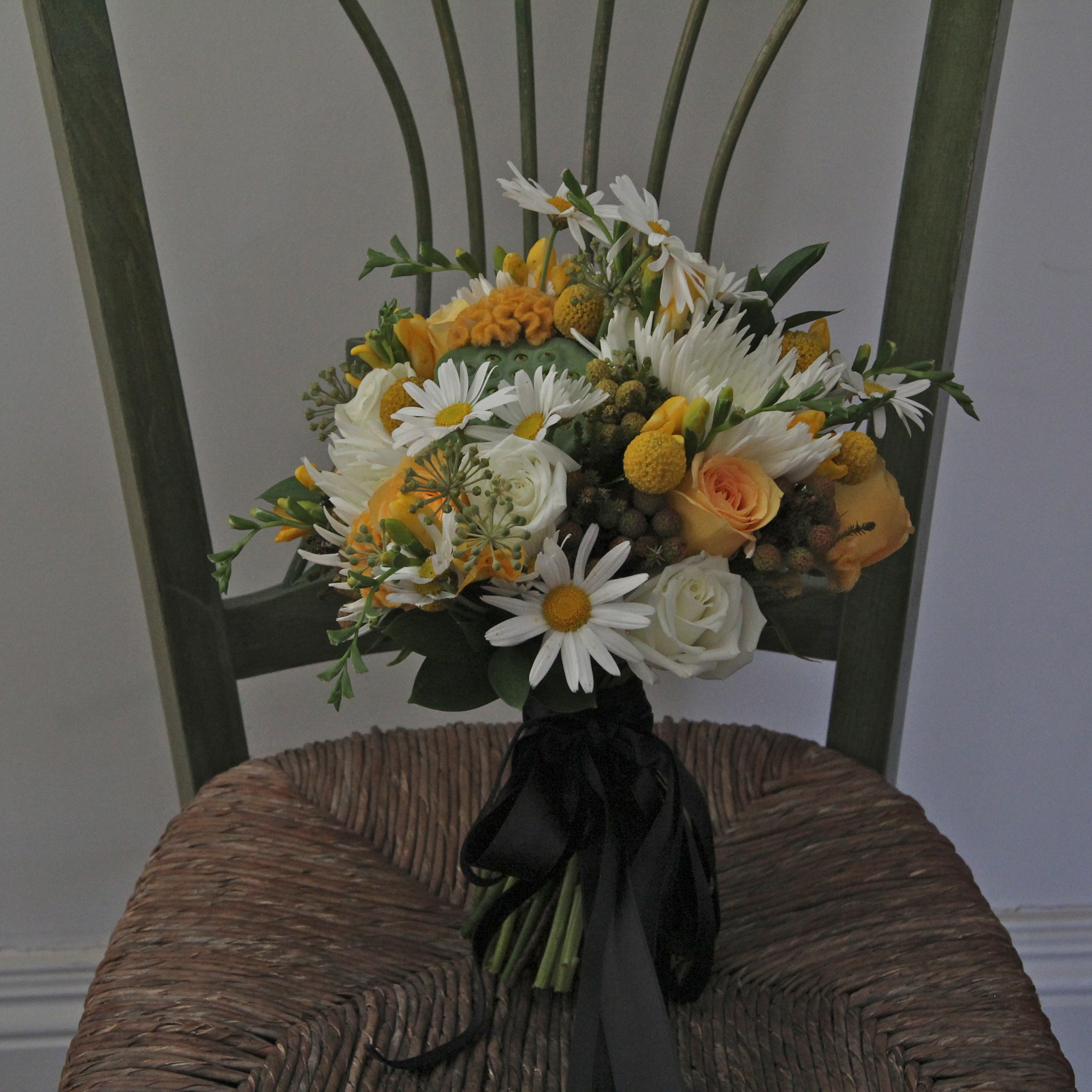Yellow and white wedding bouquet black ribbon